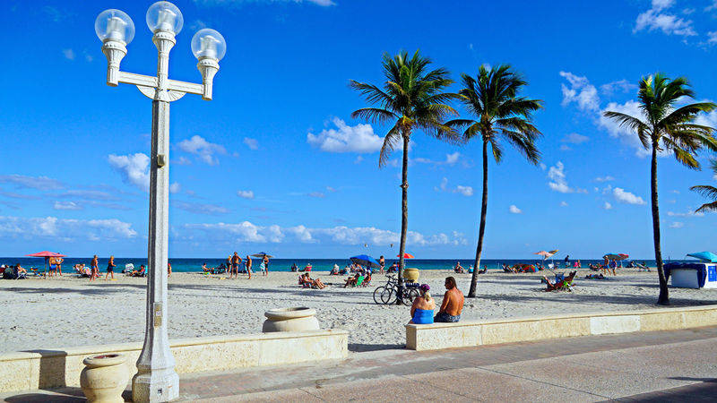 beach of Hollywood Beach, FLorida. Damon on road
